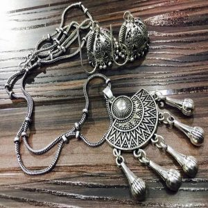 Aztec Style German Silver Pendant With Jhumkas