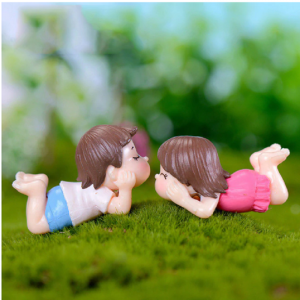 Miniature Lying Couples Dolls In The Garden