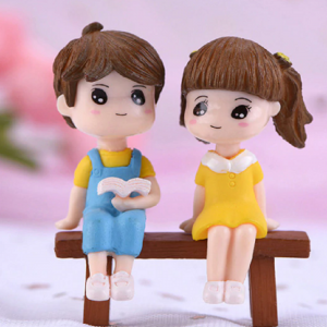 Miniature Cute Boy And Girl Reading